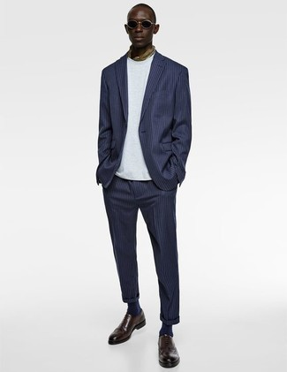 How to Wear an Olive Bandana For Men: This combo of a navy vertical striped suit and an olive bandana is hard proof that a simple casual outfit doesn't have to be boring. Put a smarter spin on this look with a pair of dark brown leather brogues.
