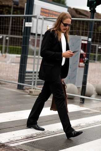 Black Leather Chelsea Boots Outfits For Men: Go for a pared down but on-trend choice by opting for a black suit and a white crew-neck t-shirt. For something more on the dressier side to finish this look, introduce a pair of black leather chelsea boots to the mix.