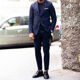 Navy Suit Outfits: A navy suit and a navy crew-neck t-shirt are a good pairing that will get you a ton of attention. Complete your look with a pair of black leather derby shoes to effortlessly ramp up the style factor of your outfit.