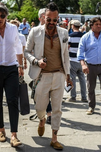 How to Wear Espadrilles For Men: Choose a beige linen suit and a tan crew-neck t-shirt and you'll be the picture of masculine refinement. Go off the beaten track and change up your look by rounding off with espadrilles.