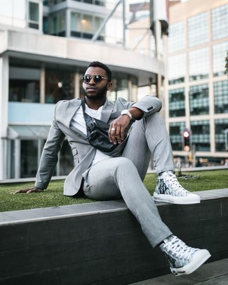 Sunglasses Outfits For Men: Extremely stylish and functional, this laid-back combo of a grey plaid suit and sunglasses provides with excellent styling opportunities. Make this look more functional by finishing off with a pair of grey print canvas high top sneakers.