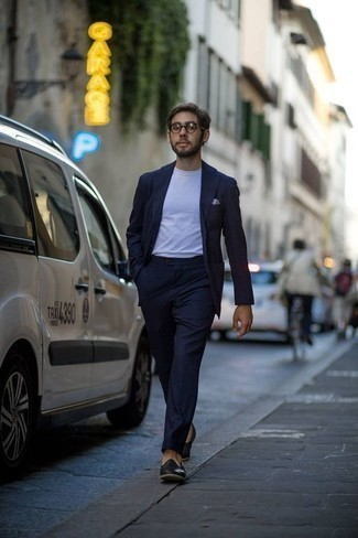 Navy Suit Outfits: A navy suit and a white crew-neck t-shirt are an easy way to inject an air of manly refinement into your casual styling lineup. Feeling transgressive today? Change things up a bit by sporting black leather loafers.