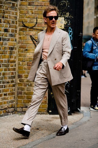 Beige Suit Outfits: You'll be surprised at how easy it is for any gent to pull together this classic and casual outfit. Just a beige suit combined with a pink crew-neck t-shirt. If you wish to instantly up the style ante of your ensemble with one piece, add a pair of dark brown leather loafers to the mix.