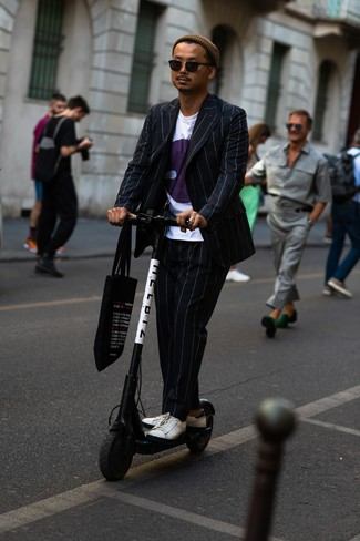 How to wear: black vertical striped suit, white print crew-neck t-shirt, white leather low top sneakers, black print canvas tote bag