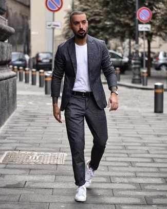 How to wear: charcoal wool suit, white crew-neck t-shirt, white low top sneakers, black leather belt