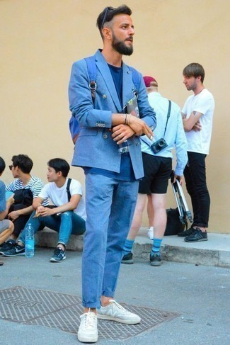 How to Wear a Blue Canvas Backpack For Men: If you don't take fashion too seriously, go for an off-duty look in a blue suit and a blue canvas backpack. White leather low top sneakers serve as the glue that brings your ensemble together.