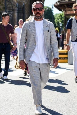 How to Wear a Black Pocket Square: A grey vertical striped suit and a black pocket square are a cool outfit worth incorporating into your current collection. Complete your ensemble with white canvas low top sneakers and off you go looking smashing.