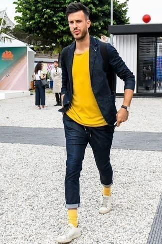 How to Wear a Mustard Crew-neck T-shirt For Men: A mustard crew-neck t-shirt and a navy suit will add sharp style to your current routine. If you want to instantly dress down this look with a pair of shoes, add a pair of white leather low top sneakers to your ensemble.