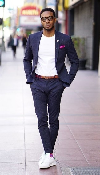 How to Wear a Hot Pink Pocket Square: We give a big thumbs up to this laid-back combo of a navy suit and a hot pink pocket square! Complement this outfit with a pair of white and green leather low top sneakers and ta-da: this outfit is complete.