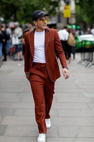 How to Wear a Tobacco Suit: Inject a touch of casual sophistication into your day-to-day styling routine with a tobacco suit and a white crew-neck t-shirt. White canvas low top sneakers will bring an easy-going touch to an otherwise standard ensemble.