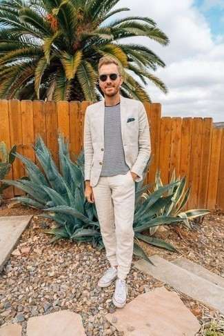 Navy Polka Dot Pocket Square Outfits: Go for laid-back and cool style in a beige suit and a navy polka dot pocket square. A pair of white canvas low top sneakers is a great choice to round off this outfit.