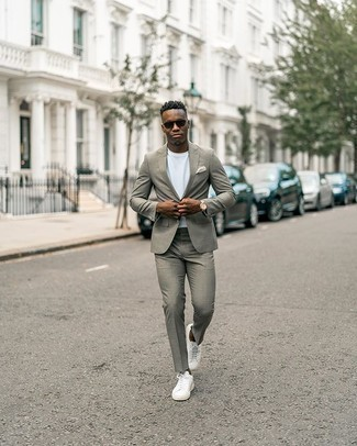 Grey Suit Outfits: For a look that's pared-down but can be dressed up or down in plenty of different ways, marry a grey suit with a white crew-neck t-shirt. A pair of white canvas low top sneakers effortlessly steps up the wow factor of your ensemble.