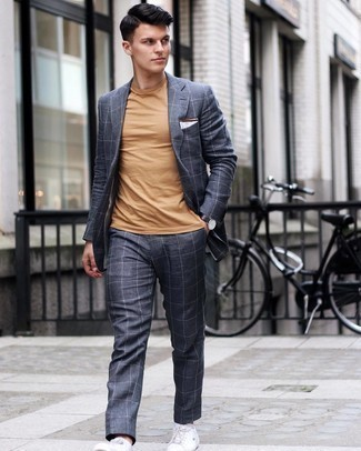 500+ Warm Weather Outfits For Men: Marry a charcoal check suit with a tan crew-neck t-shirt to look truly dapper anywhere anytime. For a more relaxed touch, why not introduce a pair of white leather low top sneakers to your ensemble?