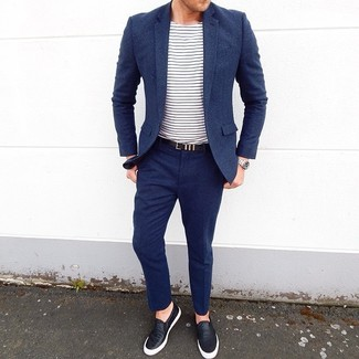 How to wear: navy wool suit, white and navy horizontal striped crew-neck t-shirt, black leather slip-on sneakers, black leather belt