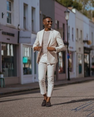 Dark Brown Suede Tassel Loafers Outfits: Rock a beige suit with a white horizontal striped crew-neck t-shirt and you'll be the picture of masculine sophistication. Dark brown suede tassel loafers will bring a more sophisticated twist to an otherwise standard getup.