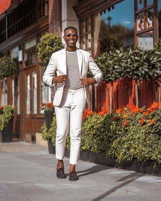 Dark Brown Suede Tassel Loafers Outfits: Putting together a white suit and a white horizontal striped crew-neck t-shirt is a surefire way to breathe personality into your day-to-day arsenal. Complete this ensemble with a pair of dark brown suede tassel loafers to instantly turn up the classy factor of your look.