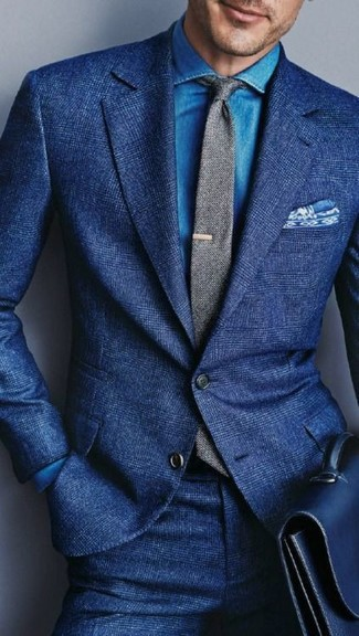This combination of a blue wool suit and a grey wool tie oozes masculinity and refined elegance. As you can see, this is a killer choice for hot weather.