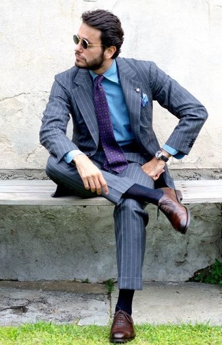 How to wear: grey vertical striped suit, blue denim shirt, brown leather oxford shoes, purple print tie