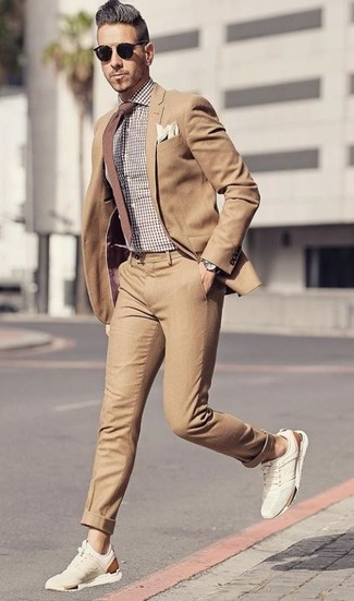 How to wear: tan suit, brown gingham dress shirt, beige suede athletic shoes, brown tie