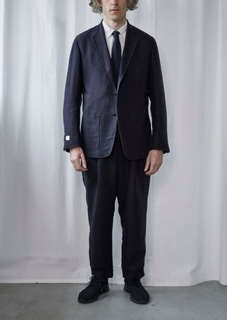 Men's Outfits 2021: Dress in a navy wool suit and a white dress shirt - this look is guaranteed to turn every head in the proximity. Add a pair of black athletic shoes to the mix to instantly ramp up the wow factor of this outfit.