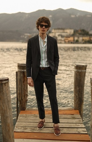 Men's Outfits 2020: A black suit and a mint vertical striped dress shirt are among the fundamental items in any modern gentleman's wardrobe. If you want to instantly tone down your outfit with one single item, add brown leather boat shoes to the mix.