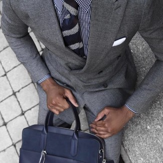 How to wear: grey suit, white and navy gingham dress shirt, navy leather briefcase, navy horizontal striped tie