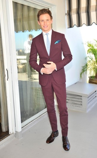 How to Wear a Burgundy Suit: Teaming a burgundy suit and a white dress shirt is a guaranteed way to inject personality into your day-to-day routine. Want to break out of the mold? Then why not add a pair of dark brown leather brogues to your outfit?