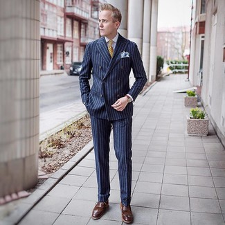 How to wear: navy vertical striped suit, white dress shirt, brown leather brogues, yellow print tie