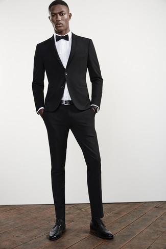 How to wear: black suit, white dress shirt, black leather brogues, black bow-tie