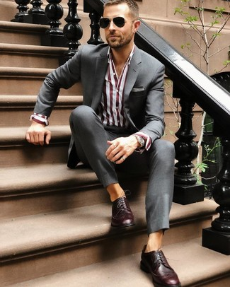 How to wear: charcoal suit, burgundy vertical striped dress shirt, burgundy leather brogues, black sunglasses