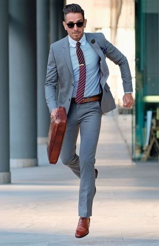 How to Wear a Red Horizontal Striped Tie For Men: Putting together a grey suit with a red horizontal striped tie is an awesome option for a classic and elegant outfit. Put a fresh spin on an otherwise dressy look by slipping into a pair of tobacco leather brogues.