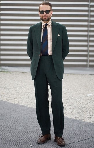 How to Wear a Dark Green Suit: Make a head-turning statement anywhere you go in a dark green suit and a tan vertical striped dress shirt. To give your overall look a more relaxed aesthetic, why not introduce dark brown leather brogues to your look?