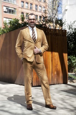 Fashion for Men Over 40: What To Wear: This combination of a tan suit and a white dress shirt comes in handy when you need to look incredibly stylish. Finishing off with brown leather brogues is a simple way to add a more relaxed touch to this outfit. If you're not sure how to dress appropriately for your age while looking stylish, this pairing is a vivid example.