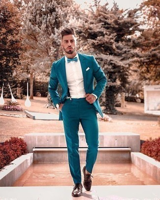 Bow-tie Outfits For Men: For a laid-back ensemble with a modern spin, consider pairing an aquamarine suit with a bow-tie. Finishing off with brown leather brogues is a surefire way to inject a hint of sophistication into this ensemble.