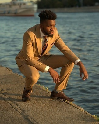 Tan Suit Outfits: Combining a tan suit and a white dress shirt is a guaranteed way to infuse your closet with some manly elegance. Complement this outfit with a pair of brown leather brogues for a fashionable on and off-duty mix.
