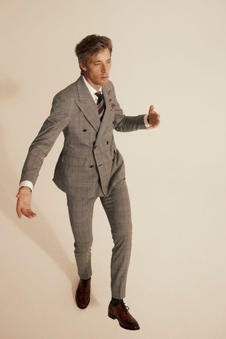 Tie Outfits For Men: This is solid proof that a grey plaid suit and a tie look amazing if you wear them together in a polished look for a modern man. Brown leather brogues will give an easy-going feel to your outfit.