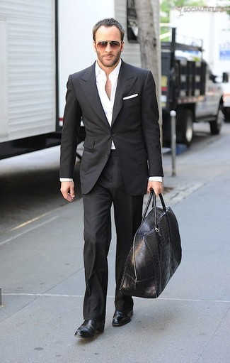 How to wear: black suit, white dress shirt, black leather chelsea boots, black leather duffle bag