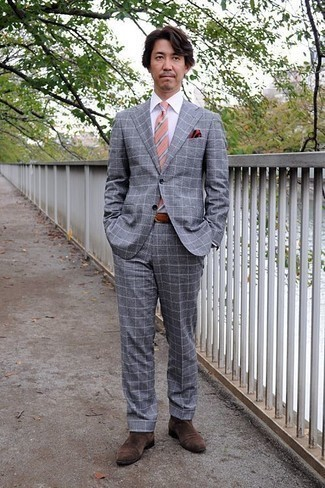 Which Suit To Wear With Brown Chelsea Boots After 40: This pairing of a suit and a white dress shirt is extra dapper and provides instant class. Take an otherwise mostly dressed-up ensemble down a more informal path by rocking a pair of brown chelsea boots.
