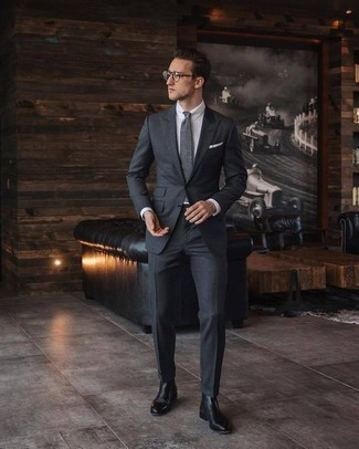 How to Wear Black Leather Chelsea Boots For Men: Exhibit your elegant side in a charcoal suit and a white dress shirt. Add a playful vibe to by finishing with a pair of black leather chelsea boots.