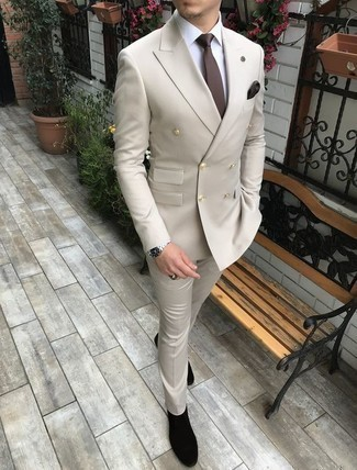 Beige Suit Outfits: This refined combo of a beige suit and a white dress shirt is a favored choice among the fashionable men. Up your whole look by rocking a pair of black suede chelsea boots.