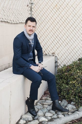 Navy Suit Outfits: Combining a navy suit and a blue print dress shirt is a guaranteed way to infuse your closet with some manly elegance. Why not add a pair of black leather chelsea boots to the mix for an easy-going feel?
