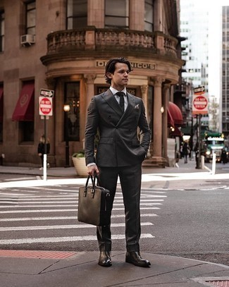 Charcoal Suit with Black Leather Chelsea Boots Outfits: Pair a charcoal suit with a white dress shirt and you will surely make an entrance. Give a modern twist to this ensemble with black leather chelsea boots.
