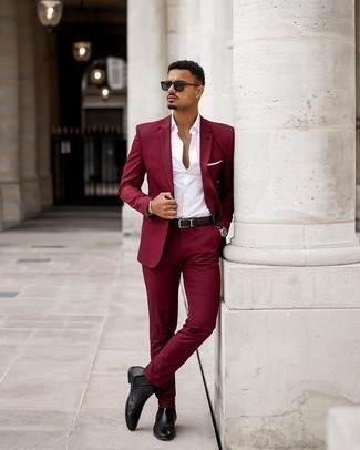 Burgundy Suit Outfits: This classy pairing of a burgundy suit and a white dress shirt will hallmark your styling expertise. Black leather chelsea boots are guaranteed to add a hint of stylish nonchalance to your outfit.