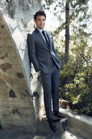 Joshua Bowman wearing Charcoal Wool Suit, Light Blue Dress Shirt, Black Leather Derby Shoes, Navy Polka Dot Tie