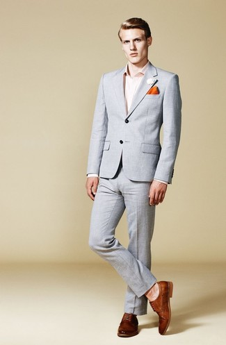How to wear: grey suit, pink dress shirt, brown leather derby shoes, orange pocket square
