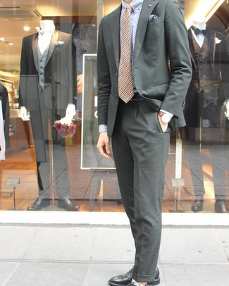 How to Wear a Dark Green Suit: You're looking at the solid proof that a dark green suit and a light blue dress shirt are amazing when teamed together in an elegant getup for today's guy. Black leather derby shoes are an easy way to inject a dash of stylish nonchalance into your ensemble.
