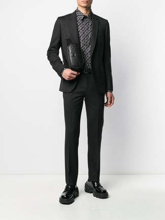 How to wear: black suit, black and white print dress shirt, black chunky leather derby shoes, black leather fanny pack