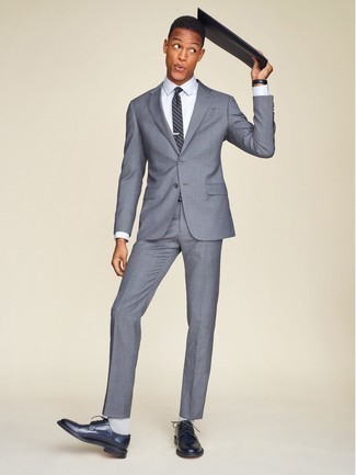 Fashion for 30 Year Old Men: What To Wear: Pair a grey suit with a white dress shirt and you will surely make an entrance. If you need to effortlesslly tone down your getup with a pair of shoes, why not complete this look with navy leather derby shoes?