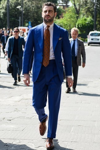 Men's Looks & Outfits: What To Wear In 2020: This pairing of a blue suit and a white vertical striped dress shirt speaks elegance and class. Add brown leather derby shoes to this ensemble et voila, this getup is complete.