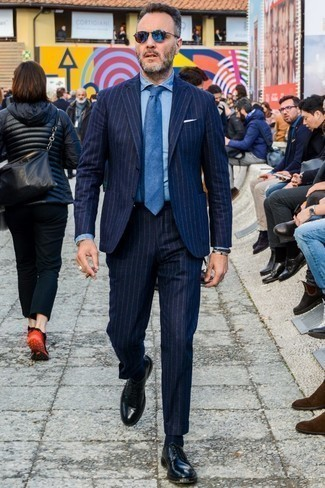 How to Wear a Blue Tie For Men: A navy vertical striped wool suit looks especially elegant when matched with a blue tie. For a more laid-back touch, why not complement your look with black leather derby shoes?
